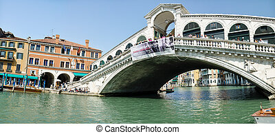 VENICE - March 28: Gondola at Rialto Bridge on March 28, 2012 in Venice, Italy. There were several thousand gondolas in the 18th century, with only several hundred today for tourism.