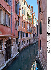 Venice narrow canal, ancient buildings and houses facades in Italy, nobody