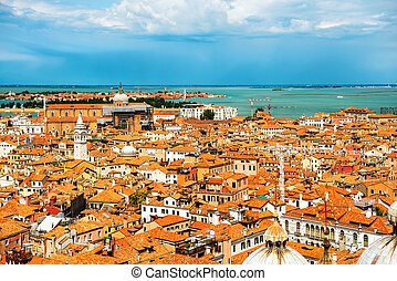 Venice roofs from above. Aerial view of houses, sea and ...