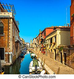 Venice San Barnaba cityscape, water canal, church and boats. Italy