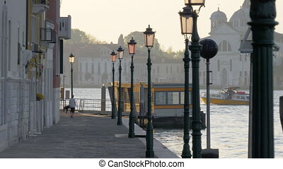Venice scene with canal and waterside street, Italy -...
