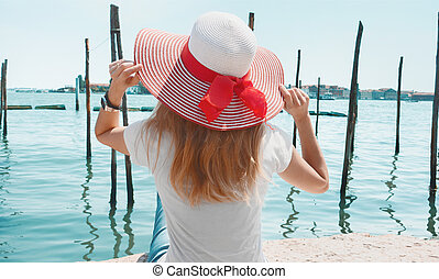 Venice, tourist with hat, port view