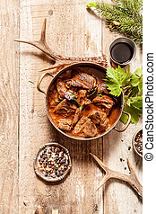 Venison Goulash in Pot on Wooden Surface - High Angle View...
