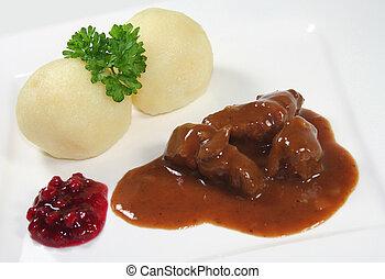 Venison goulash with dumplings and cranberries