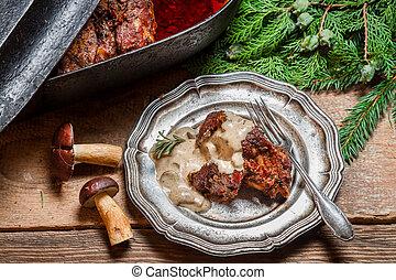Venison served with wild mushroom sauce
