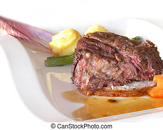 Venison meal in a white dish