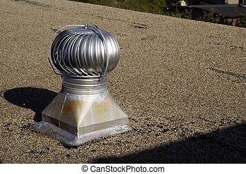 Vent on the Roof - a silver colored vent on the top of a...