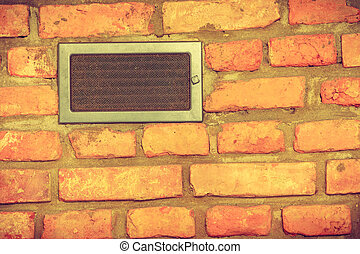 Vent window on red brick wall