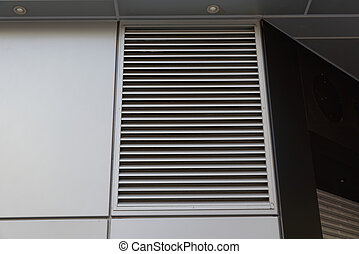 ventilation grille on the wall of a building