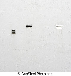 Ventilation grilles on the wall