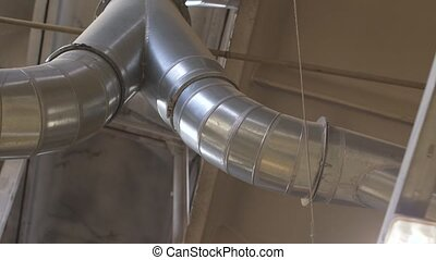 ventilation pipes at workshop or industrial room - industry,...