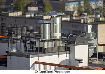 ventilation pipes on the roof of a building