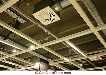 Ventilation system pipes on the ceilling of a modern factory plant building