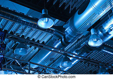 Industrial factory ceiling with ventilation system and lights
