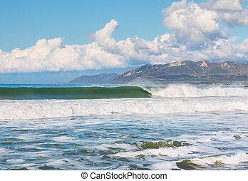 Ventura Harbor Surf - Large surf and waves breaking along...