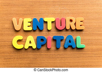 venture capital  colorful word on the wooden background