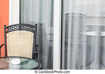 veranda with a glass door - table and chair front porch is...