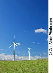 verdant hillside and windmills