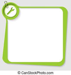 verde, em branco, caixa texto, com, spanner, e, clipe para papel
