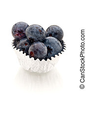 Verical image of blueberries in a silver foil cup