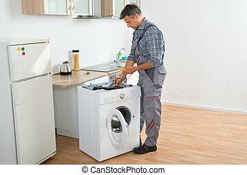 verificar, técnico, digital, máquina, multímetro, lavado