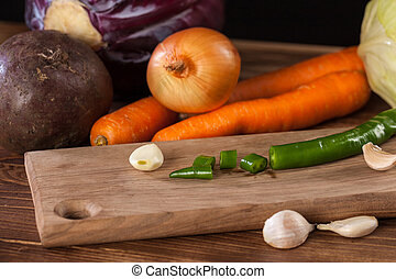 Verious fresh vegetables on a wooden table, healthy food