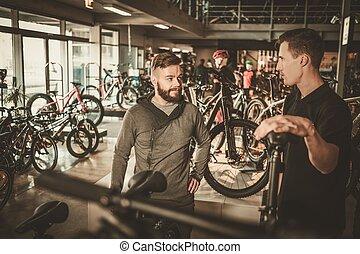 verkäufer, ausstellung, a, neu , fahrrad, zu, interessiert,...