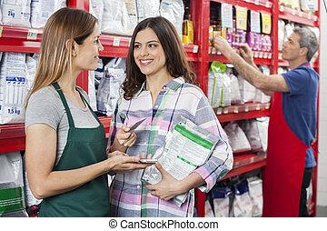 verkäuferin, annehmen, zahlung, von, kunde, in, haustier, kaufmannsladen