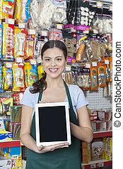 verkäuferin, ausstellung, digital tablette, mit, leerer schirm, in, haustier, kaufmannsladen