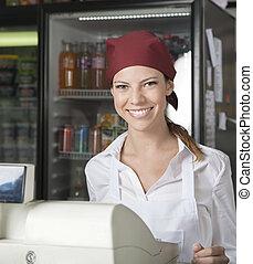 verkoopster, op, checkout logenstrafen, in, grocery slaan op
