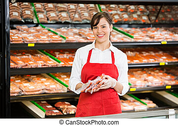 verkoopster, vlees, toonbank, vasthouden, pakketten, vrolijke