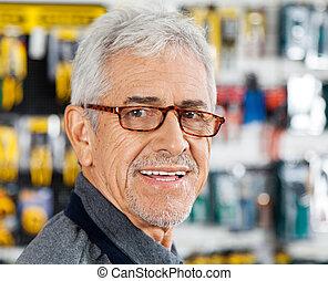 verkoper, het glimlachen, in, hardware winkel