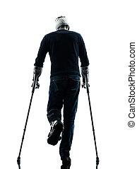 verletzt, mann- gehen, hintere ansicht, mit, gehhilfe, silhouette