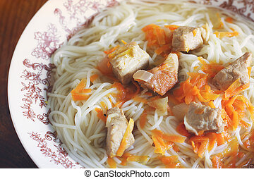 Vermicelli with meat on a plate