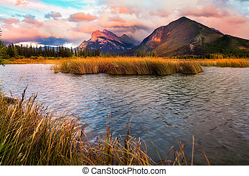 Golden early fall sunset over the Canadian Rockies and Vermilion Lakes on the outskirts of Banff, Canada