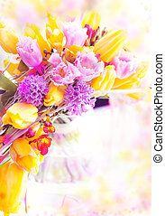 Holiday. Beautiful spring flowers - yellow tulips as festive background