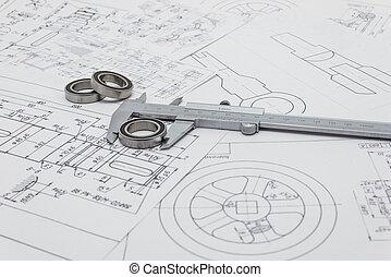 Vernier caliper lying on mechanical scheme with bearings.