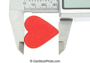 Vernier caliper measures the size of the heart and feelings. On Valentine's Day.