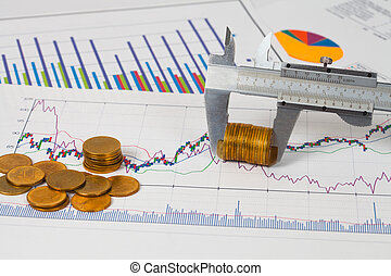 vernier measuring money coin on business chart ,business concept.