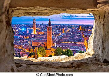 Verona historic skyline evening view through stone window