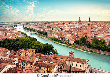 Verona, Italy. Panoramic view to Bridge Ponte Pietra in Verona. Beautiful  Sunny summer day panorama and blue sky may use as postcard or wallpaper