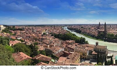 Verona, Italy. Cityscape view on the riverside with historical buildings and towers.UNESCO World Heritage Site.Panoramic cinemagraph.