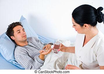 verpleegkundige, geven, pillen, om te, een, mannelijke , patiënt