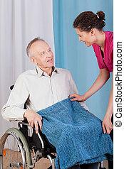 verpleegkundige, portie, gehandicapte man