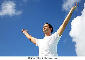 vers, étirage, ciel, bras haut, homme
