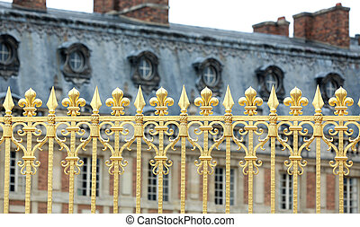 Versailles Palace Park golden gate details. France