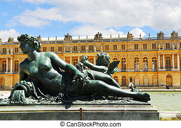 Versailles statue - Bronze statue with royal palace in the...