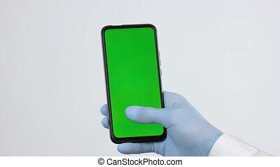 vert, gant, monde médical, utilisation, main, screen., smartphone
