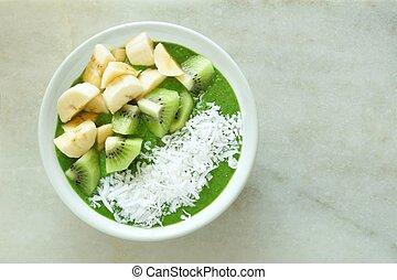 vert, smoothie, bol, à, bananes, kiwi, et, noix coco