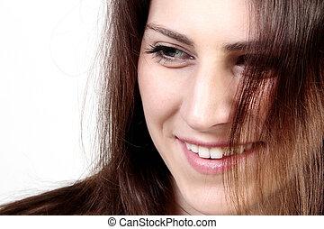 verticaal, van, een, jonge, glimlachende vrouw